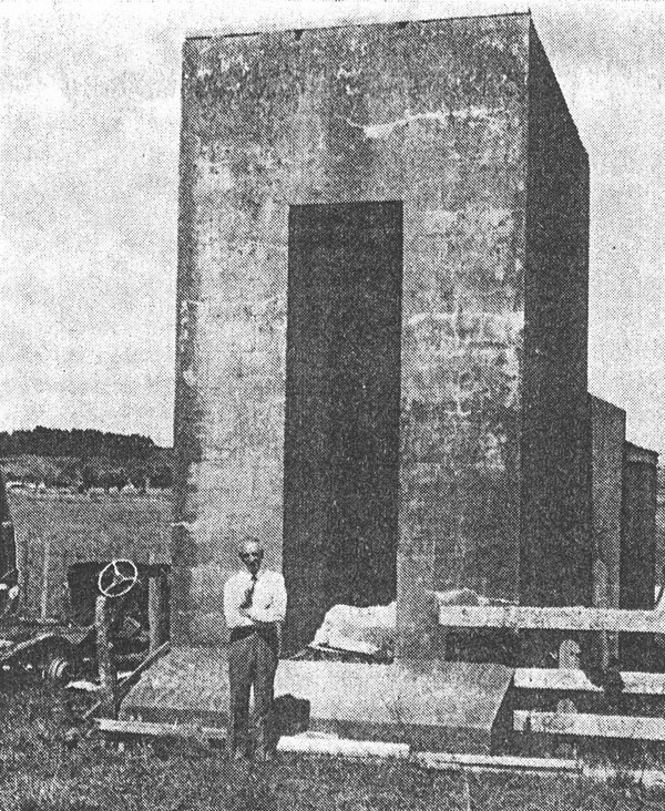 Les Elliston, the last superintendent of Awanui Radio, by one of the tower anchor blocks in 1980
