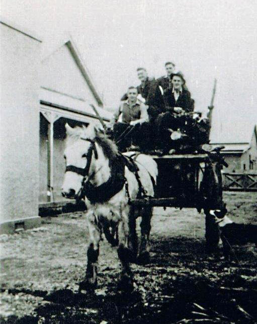 Wood-gathering expedition, outside the old receiving station, later the cookhouse / accommodation and singles quarters