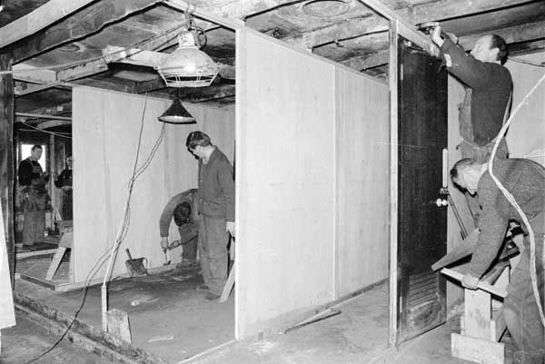 Plywood partitions being installed in the officers' burnt out quarters aboard Gothic