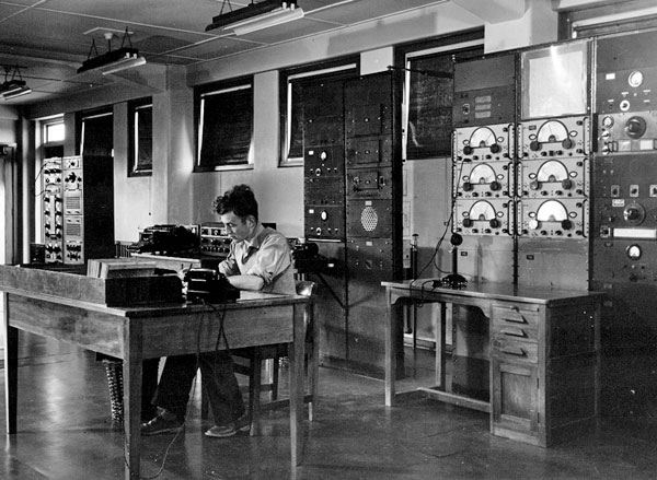 Technician P Smith with receivers at Makara Radio, c1947-1949