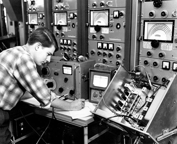 Richard Kerr servicing Marconi diversity receivers at Makara Radio
