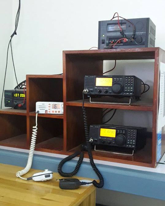 Nuku'alofa Radio A3A comprises a Standard Horizon VHF transceiver and two Icom IC-718 single sideband transceivers, Mar 2017.