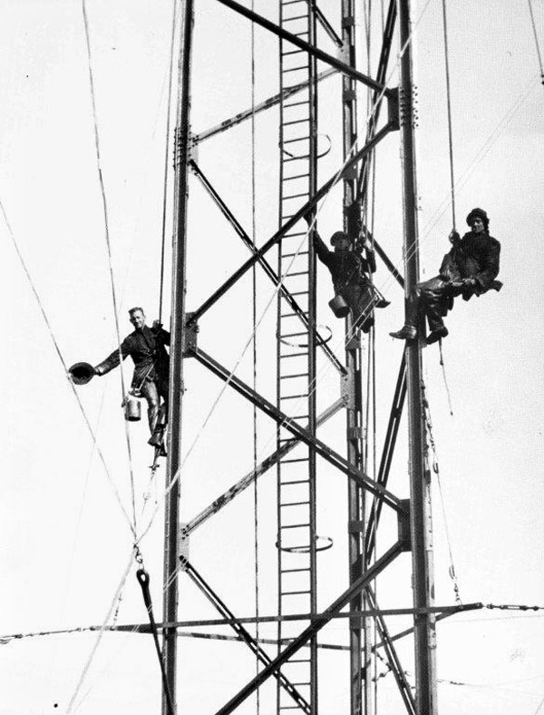 Working on the mast at Awarua Radio. The mast was approximately 400ft high and weighed about 60 tons. Date unknown.