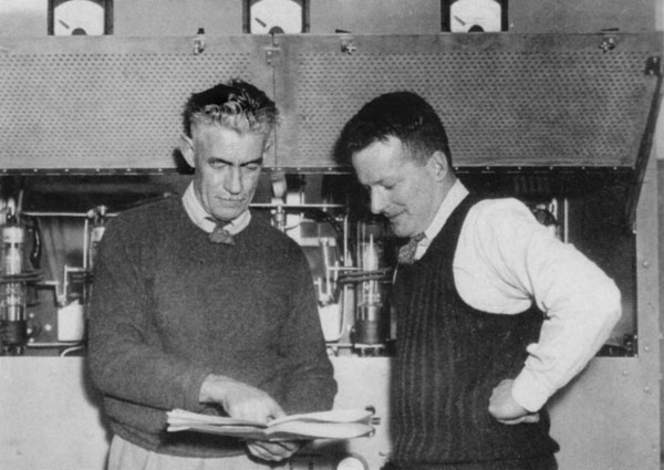 Himatangi Radio manager Jack Hogan (left) and Syd Thomson in front of the TBC-4 transmitter, c1953