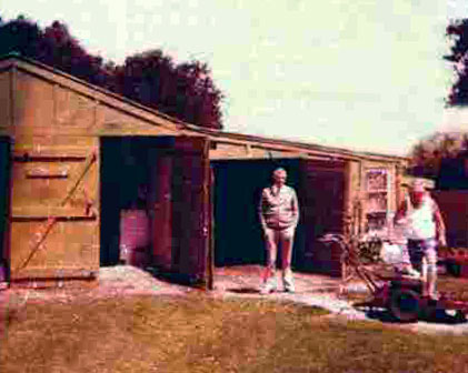Auckland Radio Manager Dennis Horan (left) and Gardener Jim Herbert in front of the old shed at Musick Memorial Radio Station