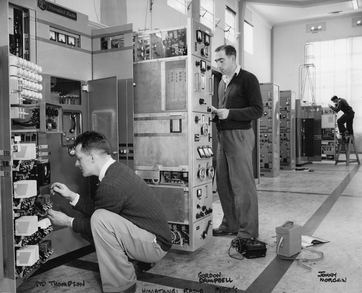Syd Thompson and Gordon Campbell work on one of four STC DS-12 4.5kW transmitters. Johnny Morgan in the background.