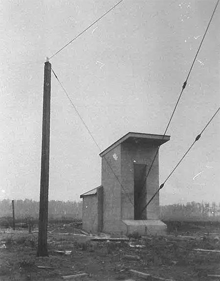 One of three anchor blocks for the tower at Awanui wireless station. There were two sets of three solid steel guys: one attached to the tower at the 150ft level of the tower, and the other at 300ft. The top 100ft of the tower was self-supporting.