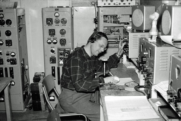 Scott Base radio room 1956-1958. The operator is unidentified (Peter Yeates, perhaps?)