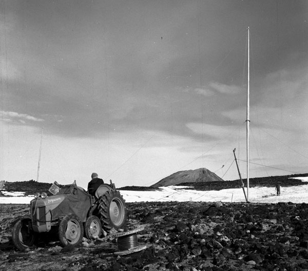 Erecting a radio mast at Scott Base for the Trans Antarctic Expedition, 1957-1959
