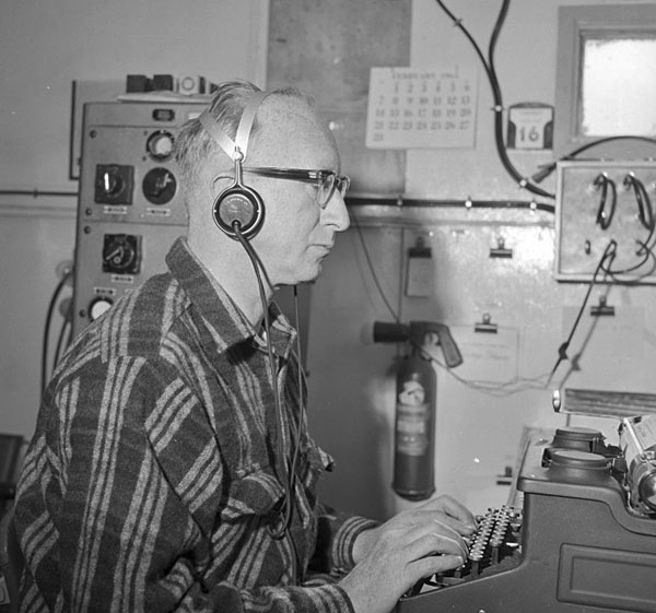 Radio operator Ted Gawn during the 1964-1965 season at Scott Base