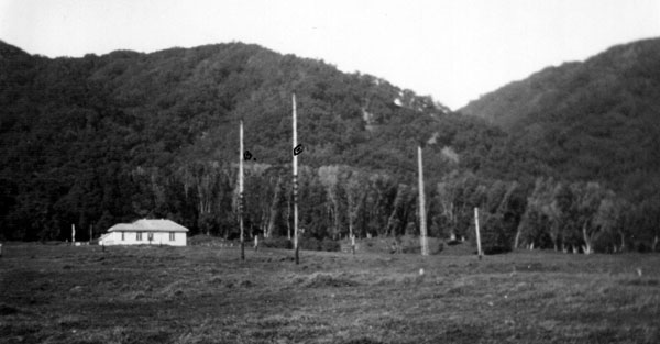 Raoul Island Radio, April 1950: Looking south towards station over poles E and B (labelled on photo)