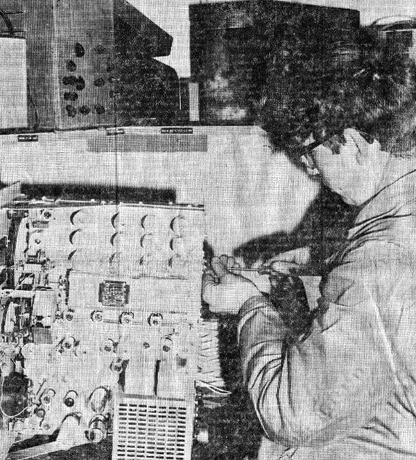 Trainee technician RC (Rex) Johnson carries out maintenance on a receiver at Awarua Radio