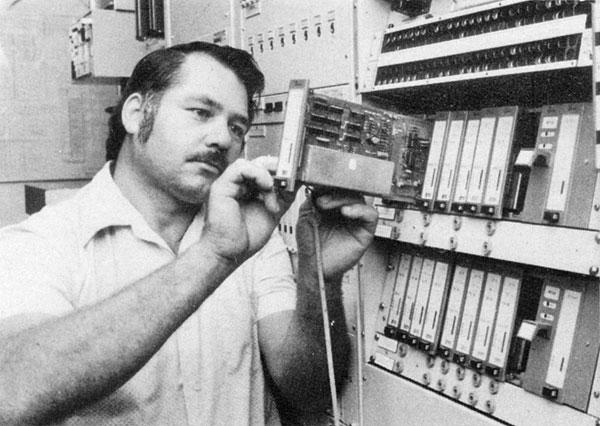 Murray Smith adjusting a Quindar telegraph channel at Himatangi Radio, c1980
