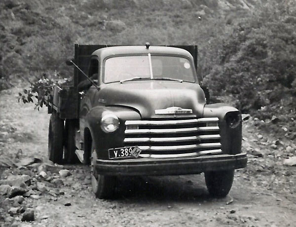 Truck on road between Milford Sound and Homer Tunnel, 1952