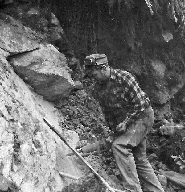 Preparing to blast rock on the road to Milford Sound c1952