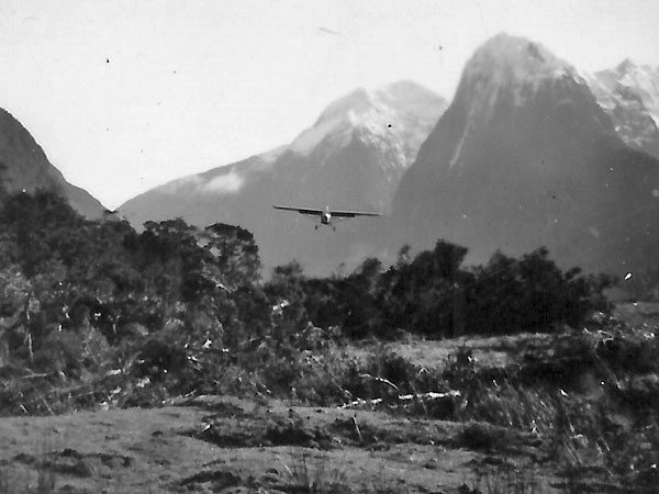 Fred (Popeye) Lucas pilots the first flight into the new Milford Sound airstrip, 1952
