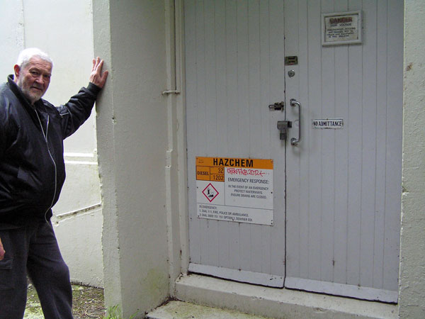 Former ZLW technician Peter Sayers at the door of the former transmitter building, 25 Aug 2017