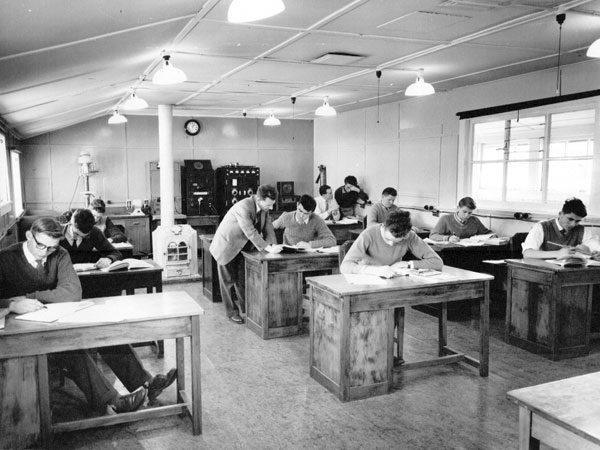 Keith Surridge (standing) with students at the Trentham radio training school in 1961