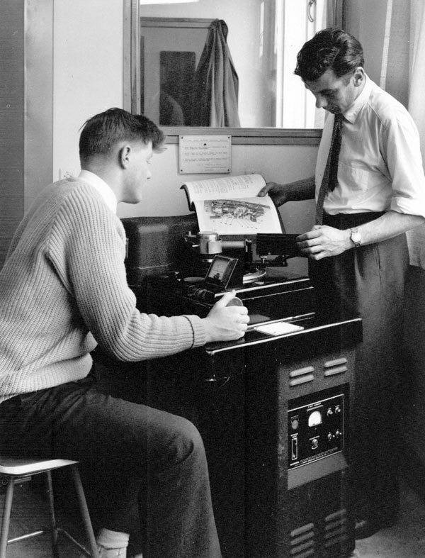 Dave Burger (seated) and Noel Miller with the X-ray machine