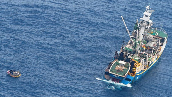 Fishing vessel Lomalo picks up eight survivors from the missing Kiribati ferry 300 kms southeast of Nauru. The fishing vessel's tender can be seen alongside the ferry's dinghy.