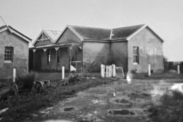 Looking northwest at the Awanui Radio operating building, with storage building at left