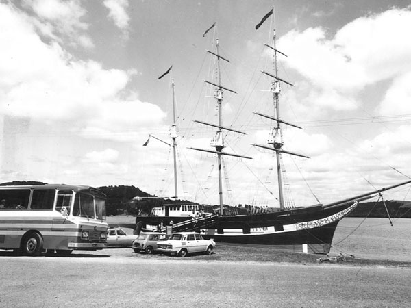 Former sugar barge Tui, hard aground and sporting the salvaged spars from Endeavour II in her role as a shipwreck museum at Paihia