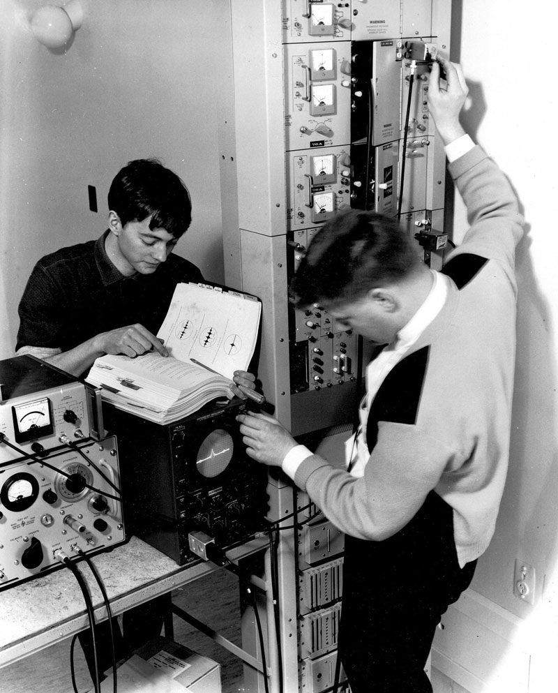Chris Underwood (left) and Dave Burger checking the Lenkurt 776 microwave bay at Wrights Hill in 1965