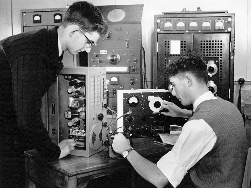 DC Moore and AE Fletcher align a communications receiver, 1961