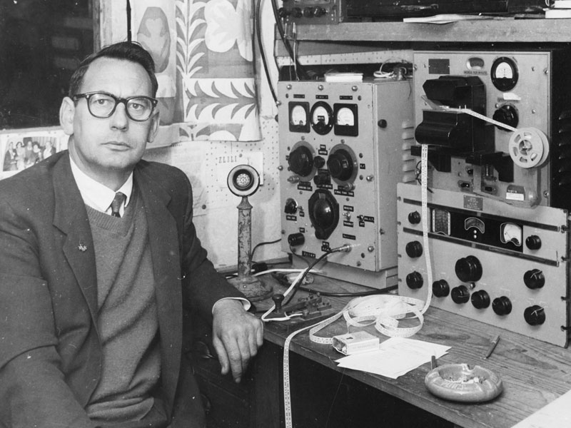 Mr MR Johnstone of Papatoetoe, a member of the Manukau Radio Club, at one of the control centres of the Amateur Radio Emergency Corps. The control centre is set up in his home. Mr Johnstone is the section leader of the Manukau section of the Amateur Radio Emergency Corps.