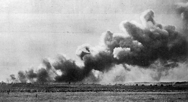 The second important step towards the establishment of the wireless telegraph station at Kaitaia, North Auckland: burning off the scrub on the site of the station