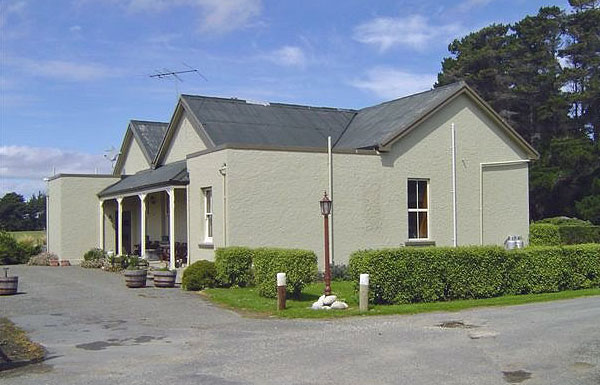 Original transmitter/operating building at Awarua Radio, erected in 1913, later converted to staff quarters and kitchen, now a private residence