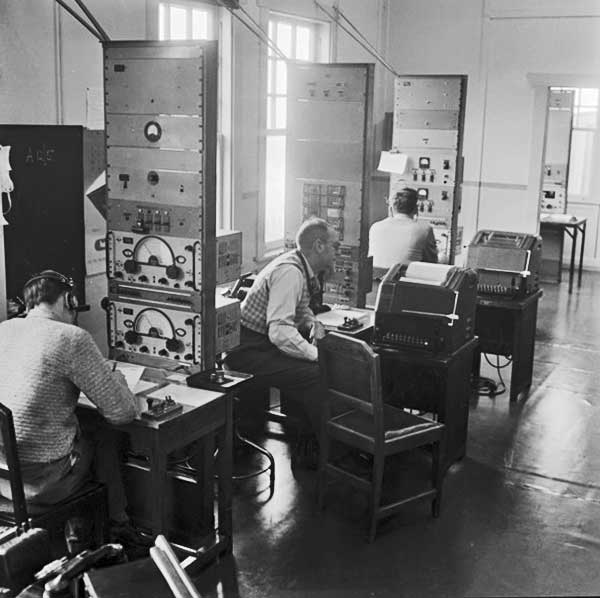 Operators at work, Wellington Radio ZLW, 28 Oct 1957. Supervisor Austin Sumner is in the middle.