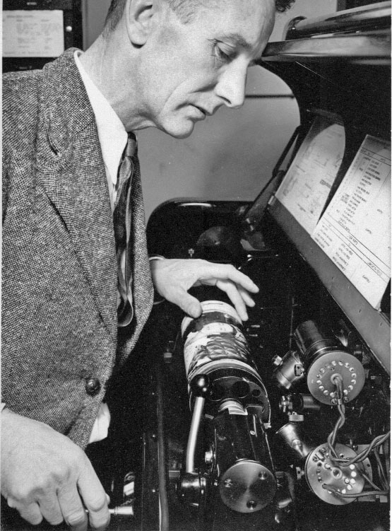Radio technician Peter Graham (?) working on a Muirhead-Jarvis facsimile machine at the Radiotelegraph and Cables Termina