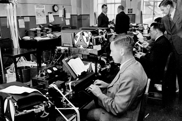 Photo labelled 'Internal Telegraph Office: Another view of some of the press transmitting positions.'