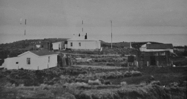 An early photo of radio masts at Puysegur Point lighthouse