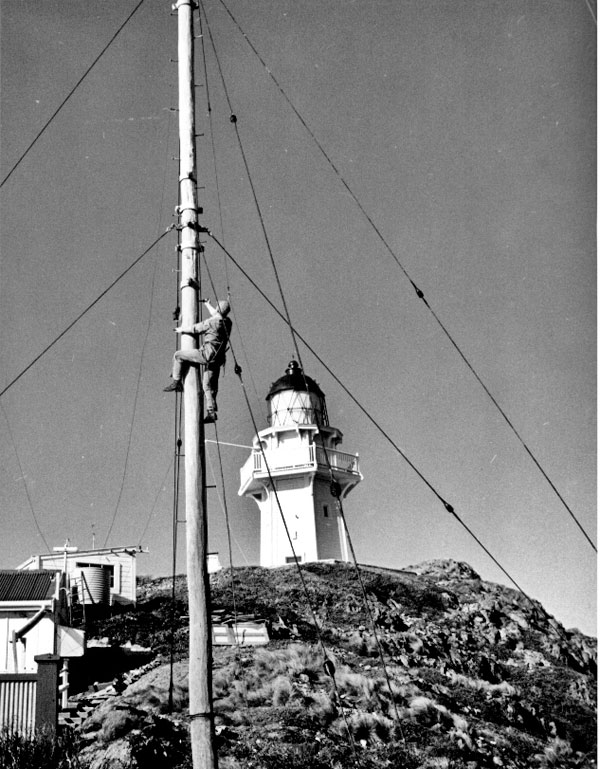 A rigger climbs one of the radio masts at Brothers Island lighthouse
