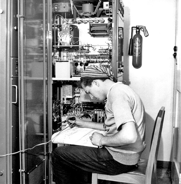A New Zealand Post Office technician works on a radio transmitter at Brothers Island lighthouse