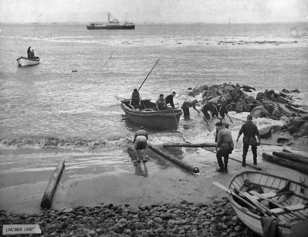 Post Office linesmen bringing radio poles ashore at Dog Island, c1953