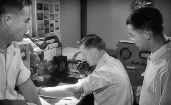 Cuvier Island light keepers at their radiotelephone in 1956