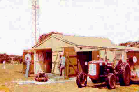 Auckland Radio Manager Dennis Horan and Gardener Jim Herbert in front of the old shed at Musick Memorial Radio Station