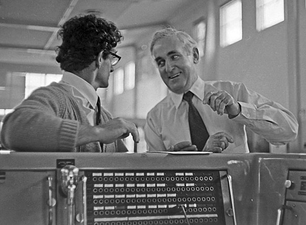 George King (right) Officer-in-Charge, Himatangi Radio shares a light-hearted moment with Deputy-OIC Don Snadon at the control console, c1974