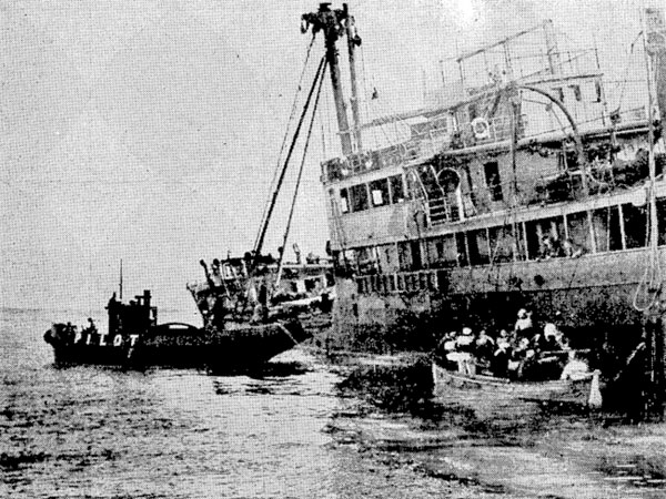 The crew of the steamer Waikouaiti about to leave in the ship's lifeboat, towed by the pilot launch
