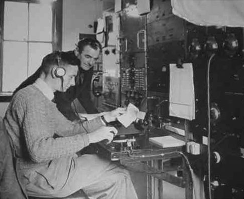 Radio operator Clyde Williams at Milford Sound Radio in March 1954