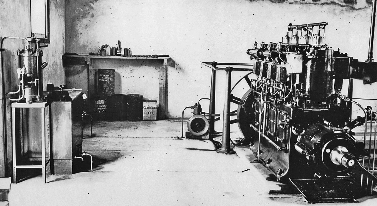 Engine room at Awanui Radio showing the 75hp Gardner engine. This photo may have been taken some time after the station opened, as there is a large crack in the wall (visible at top right of photo).