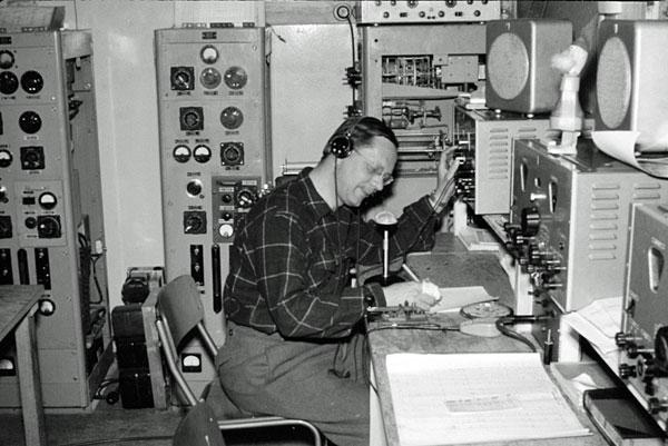 Scott Base radio room 1956-1958. The operator is unidentified (Peter Yeates, perhaps?)