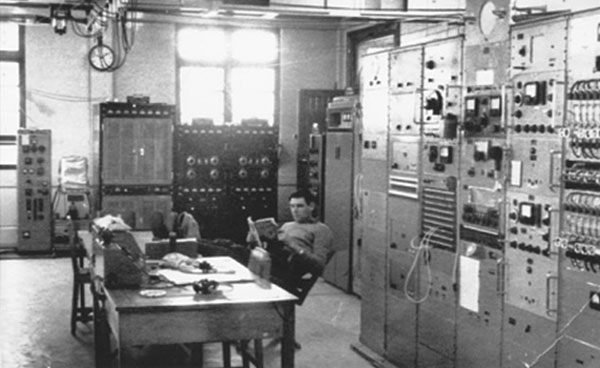 Technician Brian Gallagher in the Wellington Radio ZLW transmitting hall during the late 1950s or early 1960s