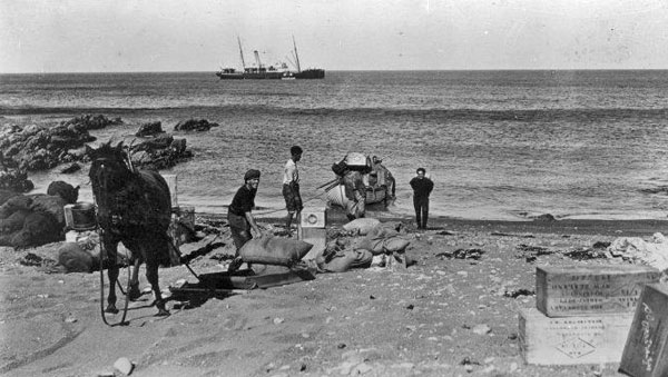 Crew from the government ship Tutanekai landing stores at Pencarrow lighthouse, 16 Feb 1923