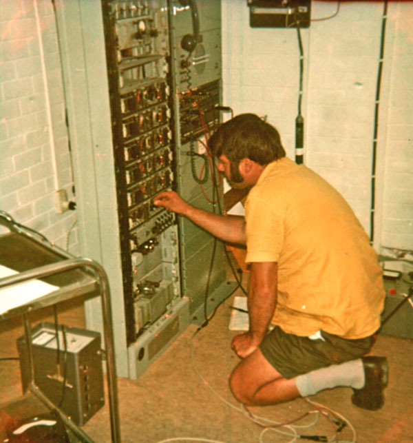 Murray Smith checks the GEC link equipment at North VHF, c1970s