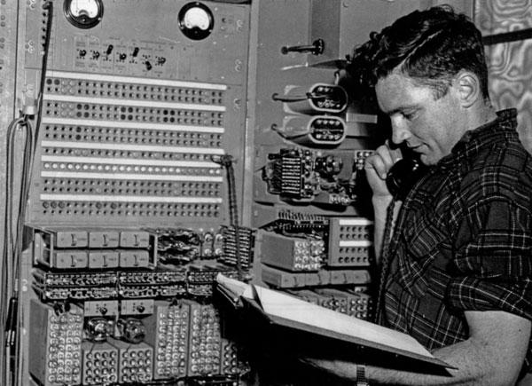 Laurie Edgerton checks speech circuits over a landline at Himatangi Radio, 1953