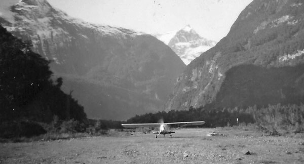 Fred (Popeye) Lucas heads for the 'terminal' at the new Milford Sound airstrip, 1952